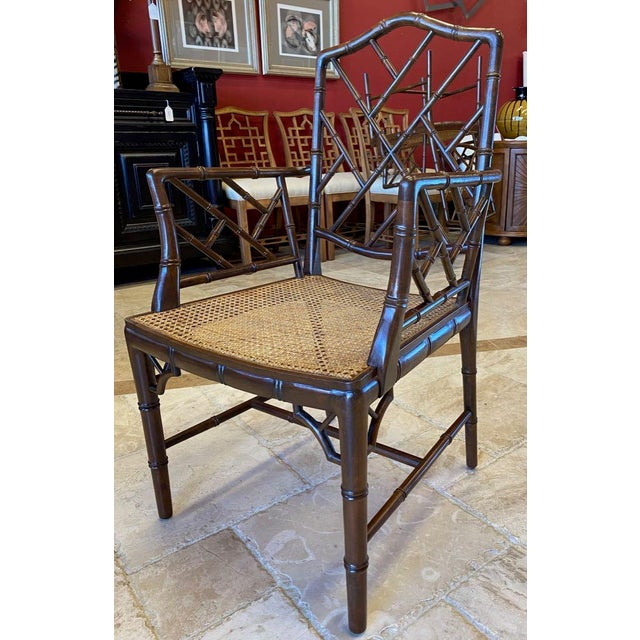 Chinoiserie, faux bamboo arm chairs with caned seats. Chinese Chippendale lattice back, arms and corner brackets. Use them...