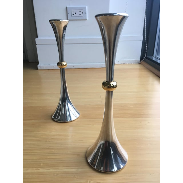 Tall and elegant silver-plated candleholders with brass detail designed by Jens Quistgaard for Dansk. Labeled with JHQ....