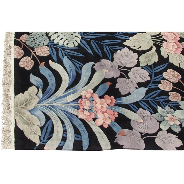 :: Sprawling densely ornamented jungle themed design motif with long leaves, vines, detailed floral petals, and blossoms,...