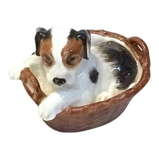 Vintage Porcelain Puppy in a Basket Figurine For Sale