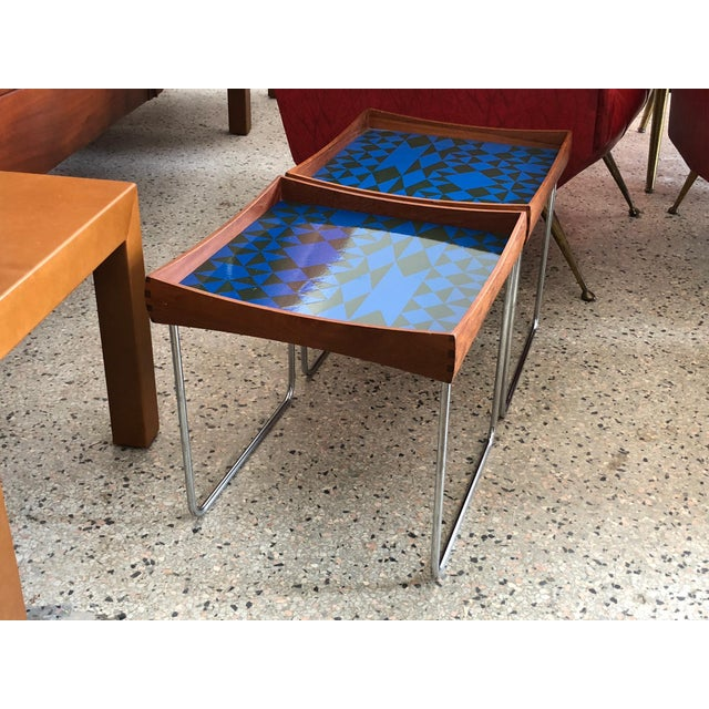 This is a pair of unusual enamel tray top tables by Hermann Bongard for Plus, Norway, circa 1960s. The tops are removable.