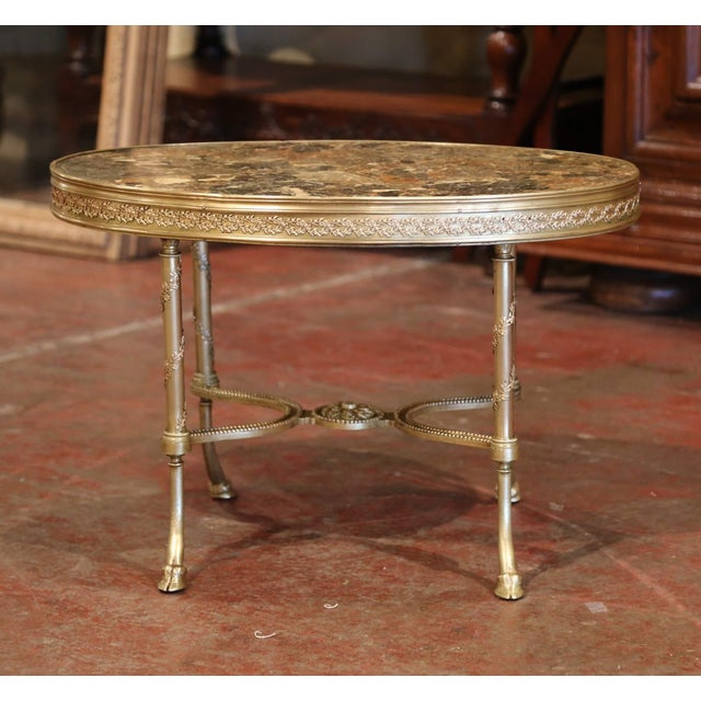 This elegant, baroque Louis XVI style coffee table was created in France, circa 1870. Seated on four bronze legs, the oval...