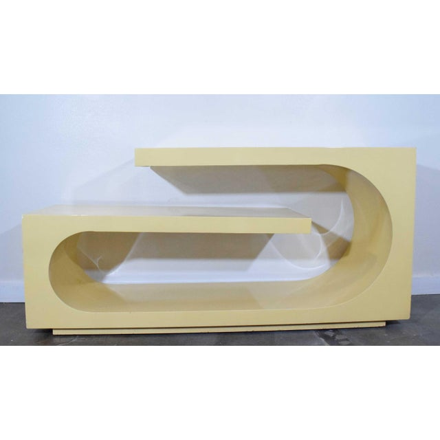 Console is very well made in lacquered wood. A great looking piece. We can re-lacquer in color of choice is desired.