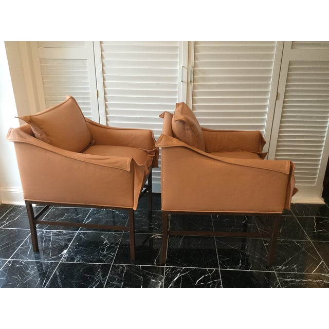 Fantastic pair of leather arm chairs upholstered in the softest, most supple melon leather. Wonderfully comfortable for...