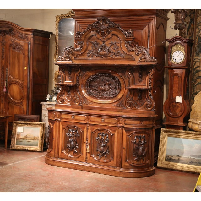 This exceptional, antique sideboard was crafted in France, circa 1850. The unique, highly detailed cabinet is made of...