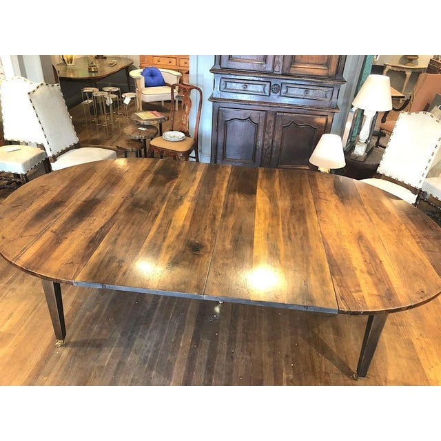 Fine quality 19th century Louis XVI style French Provincial extending dining table. Made of beautifully patinated and very...