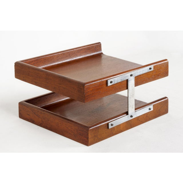 1960s modern walnut paper tray with steel bracket. This uncommon, two-tier organizer features rounded edges and a great...