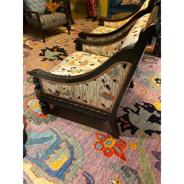 A pair of 19th century Chinese mother of pearl inlaid rosewood chairs. Embellished arms, legs and backs. Newly...
