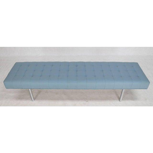 Light blue tufted modern upholstery bench.