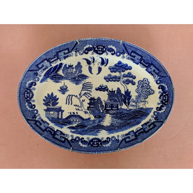Vintage Blue Willow Pagoda Blue and White Decorative Platter Comes with a plate hanger 3 small chips around the edge,...