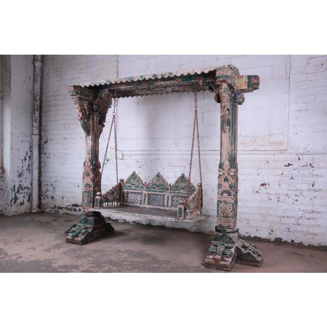 Offering a rare and unique antique handcrafted and painted Indian Jhula bench swing. This exceptional swing was made in...