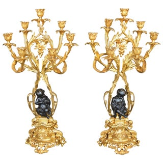 Pair of Bronze Putti Candelabras For Sale