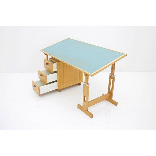 Adjustable pine wood desk with container by ASKO, Finland. Linoleum-coated worktop in pigeon blue, leather tabs on the...