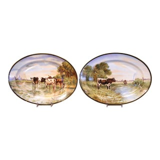 Pair of 19th Century French Limoges Painted Porcelain Cows Wall Platters For Sale