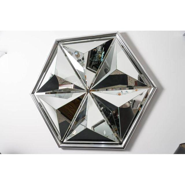 This 1970s hexagonal polygon-shaped wall mirror is the perfect piece to give your wall an optic-transformation as its many...