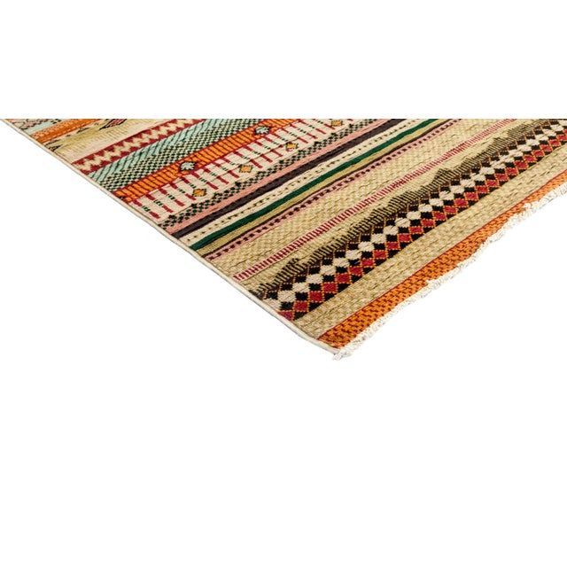Made in Pakistan. Featuring fields of stripes with subtle patterns differentiating each row, these rugs are quietly...
