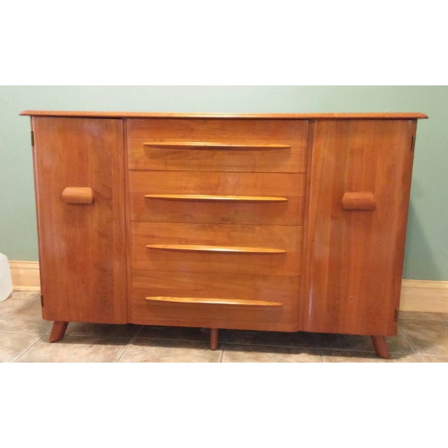 Crafted of 100% solid walnut, this Mid-century buffet was designed by Carl Bissman, and is in excellent, original...