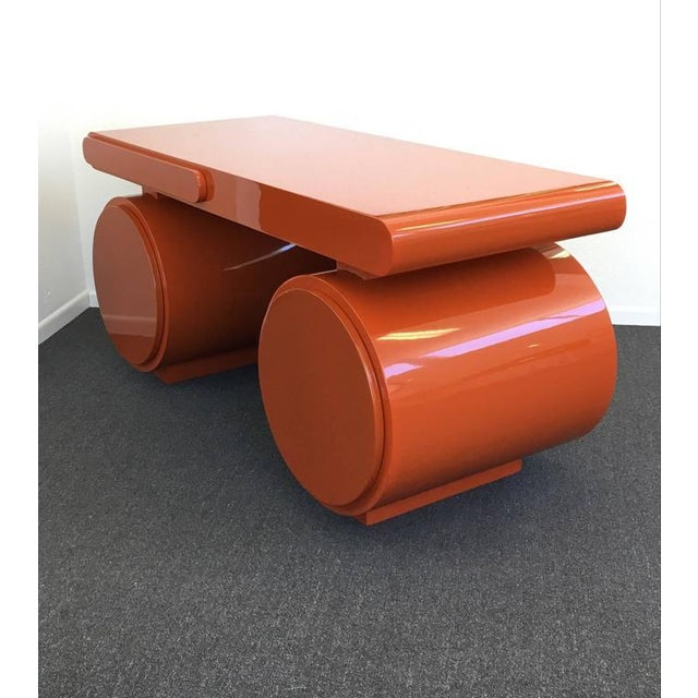 A spectacular 1960s scuptural desk with a orange high gloss lacquered finished. The desk has three drawers. One small of...