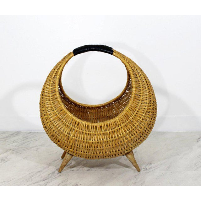 For your consideration is a marvelous, wicker basket with a black leather wrapped handle, attributed to Franco Albini. In...