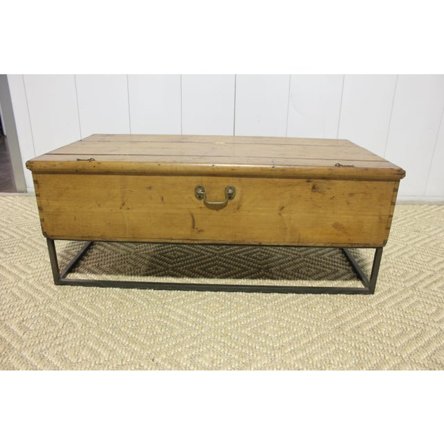 Trunk coffee table on metal base. Can also be used as blanket bench at foot of a bed.