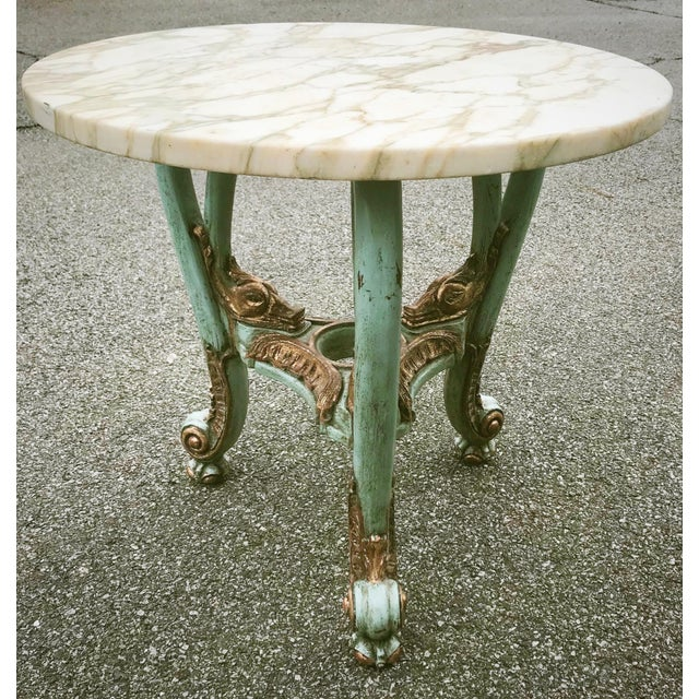 This round table is constructed in carved and polychrome wood. It has a marble top in circular shape. Beautiful carvings...