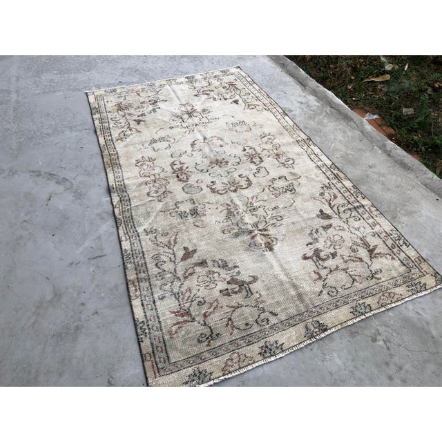 This is a handwoven Turkish OUSHAK rug. We collect antique rugs from Anatolia, which is the Eastern part of Turkey, and we...