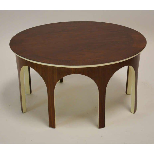 Rare walnut colosseum cocktail table accented with ivory lacquer. Recently refinished and repainted.
