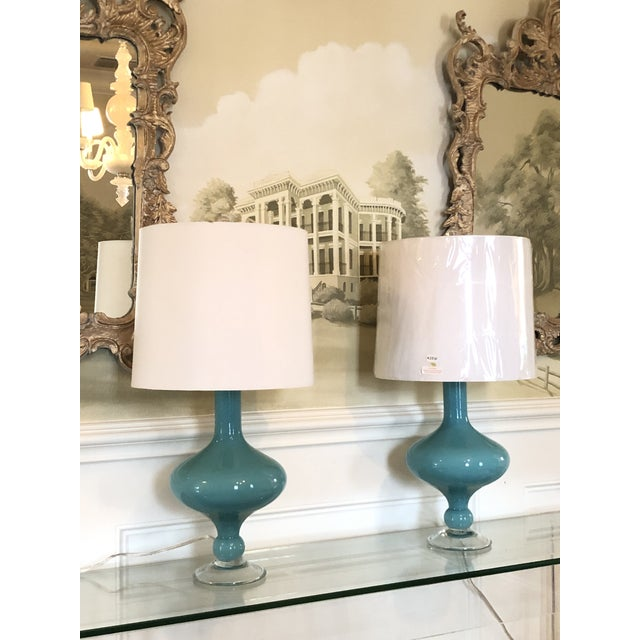 Pair of Arteriors Rory table lamps with silk shades. One shade is new and one has minor markings. Beautiful pop of blue...