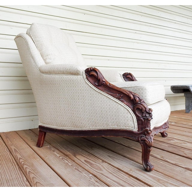 Heavily hand carved mahogany rococo style bergere chair. Circa 1930's , newly reupolstered with new springs and cushions....