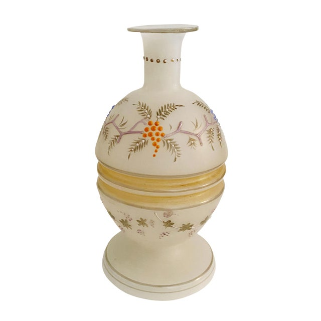 An opaline glass vase with a distinctive egg shape and Handpainted with grapes and vines. Circa 1840's.