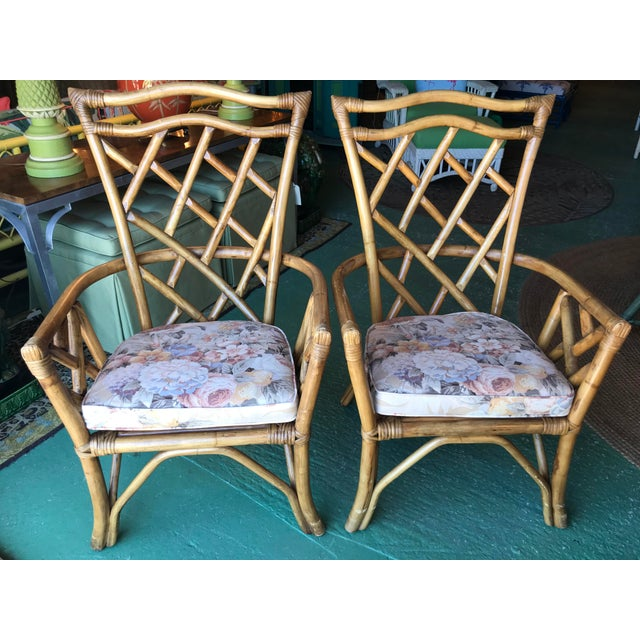 Great vintage Rattan Chippendale chairs ready for some new fabric. These chairs would be great on a porch, bedroom or even...