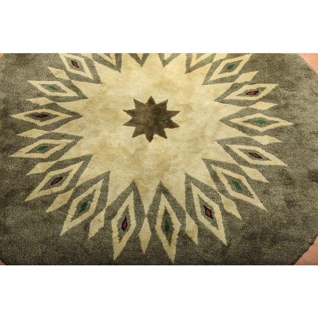 """Paule Leleu (1906-1987). A round French Art Deco wool rug, signed """"Leleu,"""" similar model illustrated on page 392 of """"Leleu..."""