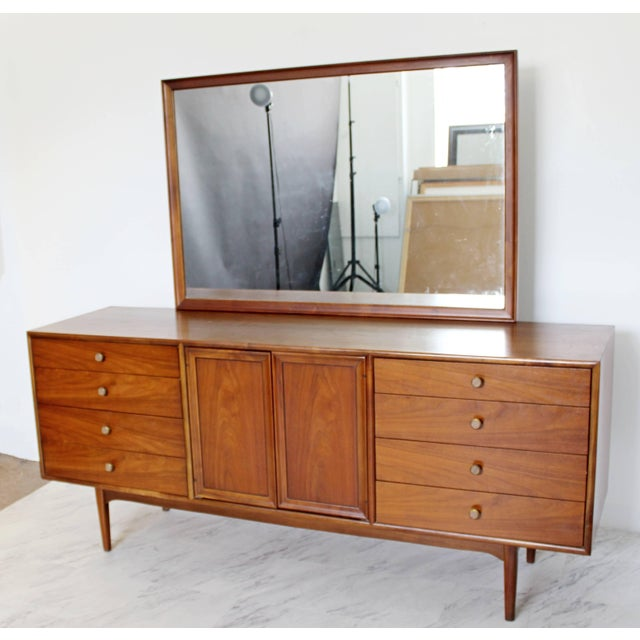 For your consideration is a stunning, walnut lowboy, with an attached mirror and brass and wood knobs on its eight outer...