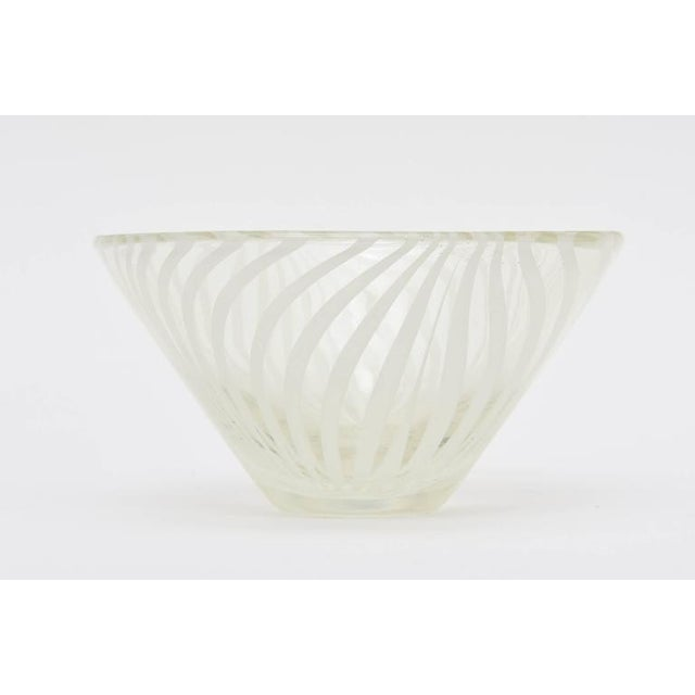 This lovely modern Swedish white clear swirled optical bowl is signed. It is not legible but shown in the photos. Great...