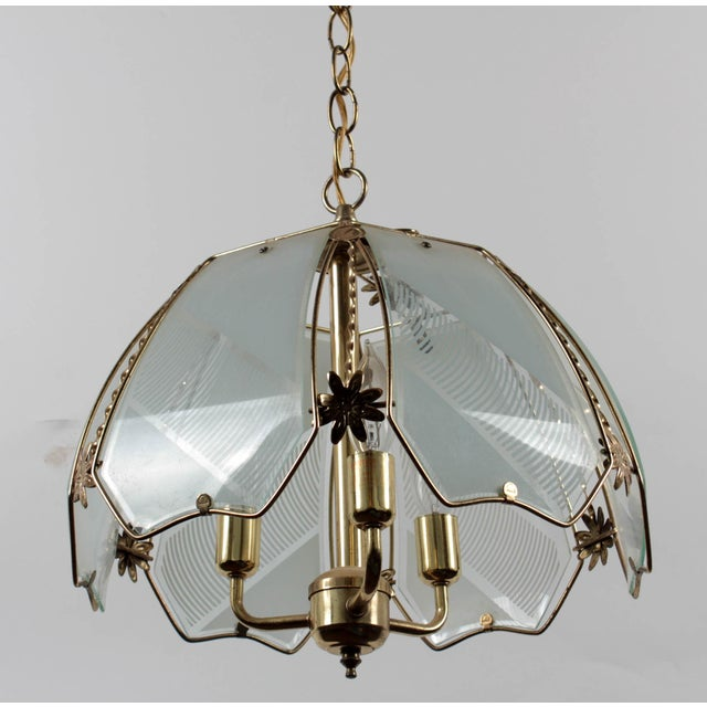 Brass and frosted pattern glass ceiling pendant lamp with floral decoration. Label/mark: Vintage Union Made and UL...