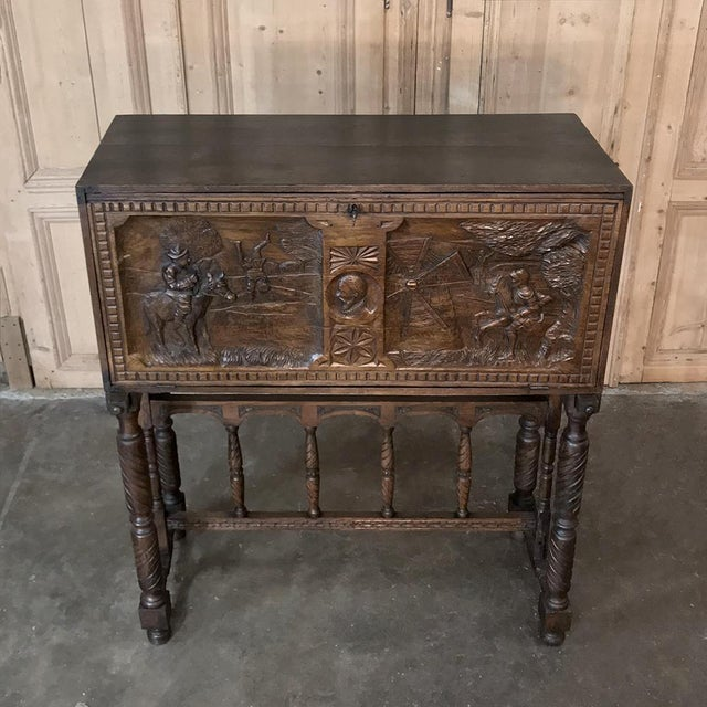 19th Spanish Raised Cabinet Carved with Don Quixote is a charming piece unto itself, and sometime in the early 20th...