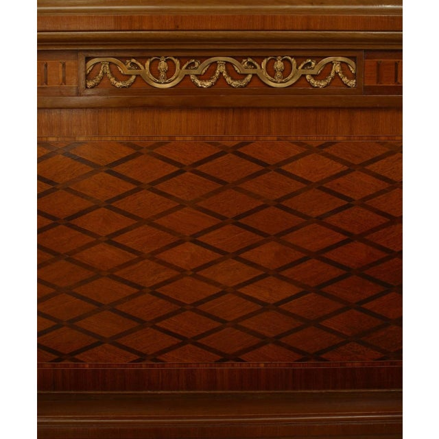 French Louis XVI style full size mahogany bed with gilt bronze ormolu mounts and marquetry inlay (headboard, footboard,...