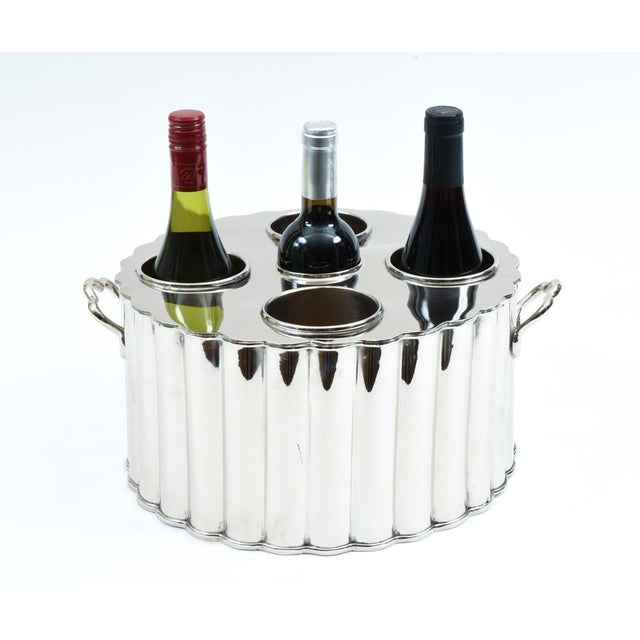 Silver plated barware / tableware four bottles wine holder with side handles with exterior design details. The barware...