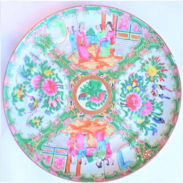This is a beautiful antique Rose Famille Medallion large plate. The plate is hand painted in vivid hues of magenta, kelly...