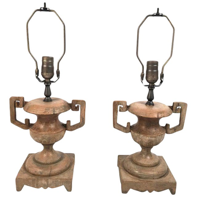 A stylish pair of French carved wood urn-form lamps, with geometric strap handles on scalloped square bases. Newly...