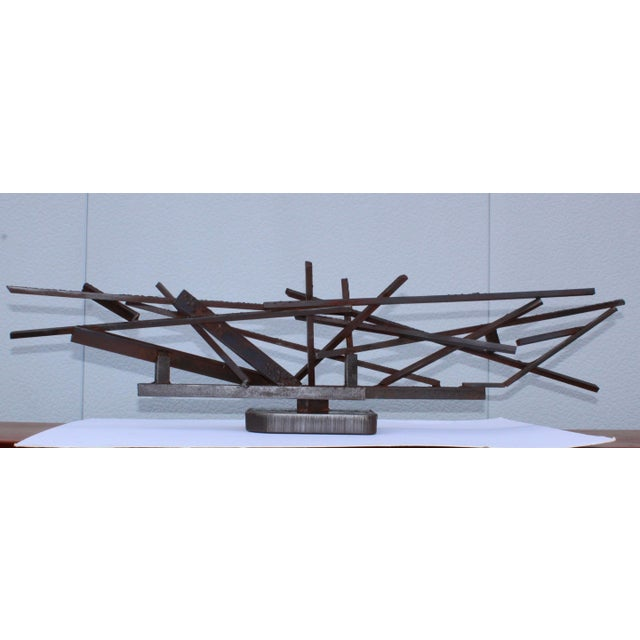 Stunning oversize 1960s welded steel modernist sculpture. In vintage original condition with some wear and patina.