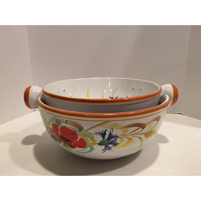 """Unusual hand painted pasta bowl & strainer combined in one. Made in Italy Artist signed Measures 13"""" x 11"""" x 5"""" Makes a..."""