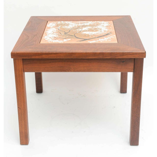 This handsome side table was created by Brown Saltman in the 1960s. The enamel inset panel is decorated with a stylized...