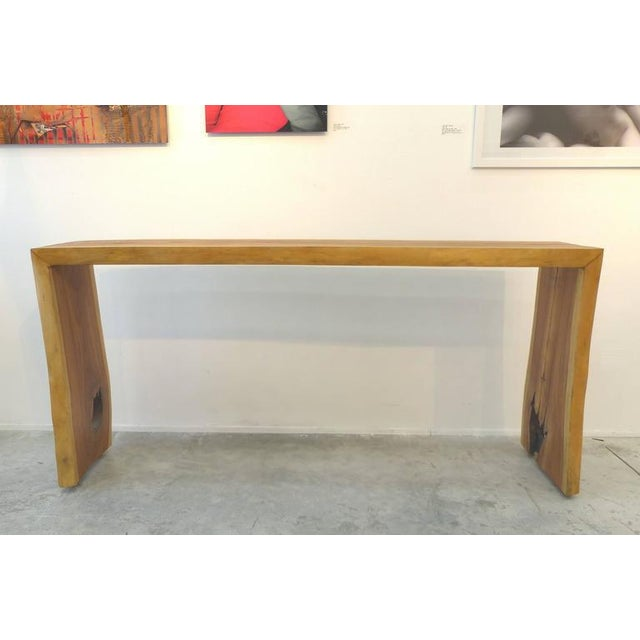 A beautifully grained garapa wood console table created by Brazilian artist Valeria Totti with wood salvaged from the...