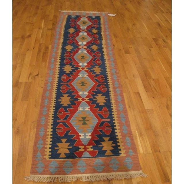 Bold and colorful, this kilim runner rug was handwoven in Turkey. Pizzazz for your hallway. New.