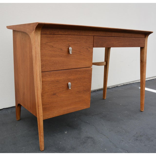 Vintage three drawer walnut desk designed by John Van Koert for Drexel. Good condition with only normal wear: small nicks...