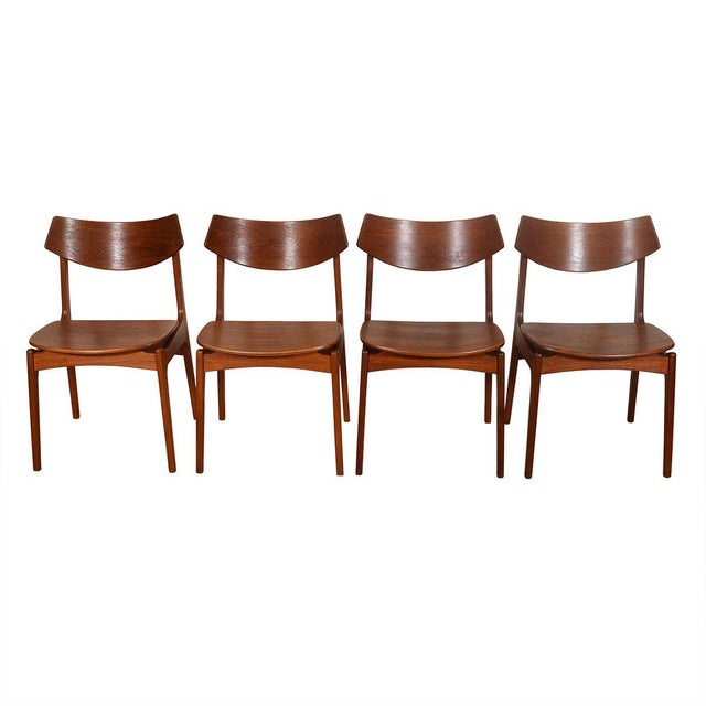 We are pleased to offer this lovely old set of 4 Danish Modern dining chairs in teak. The backrest is comprised of a...