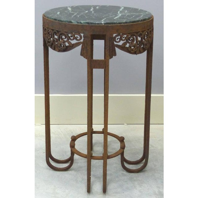 This is a pair of period French Art Deco wrought iron marble top tables by Paul Kiss. The tables have Classic Kiss...