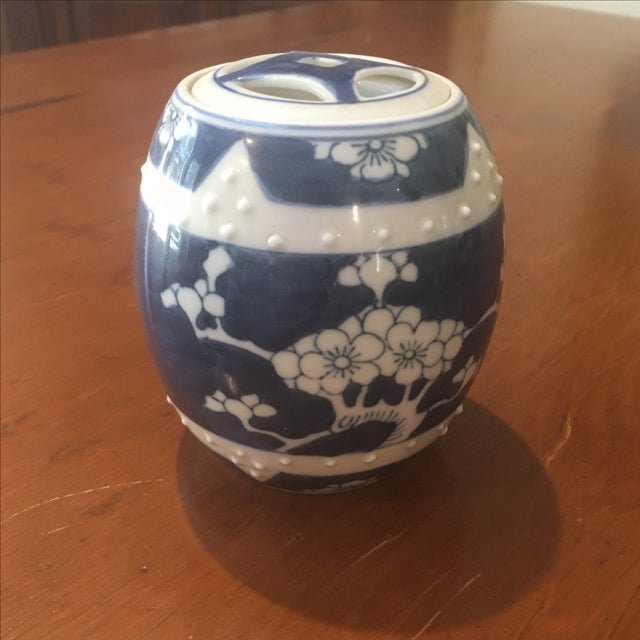 Cute blue and white jar with painted cherry blossom motif. Looks like a mini garden seat.