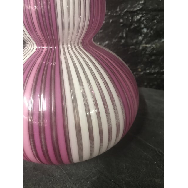 An Exceptional Mid Century Tall Murano Glass Mezza Filigrana Vase with Hot Pink and White fused canne ribbons. A true...